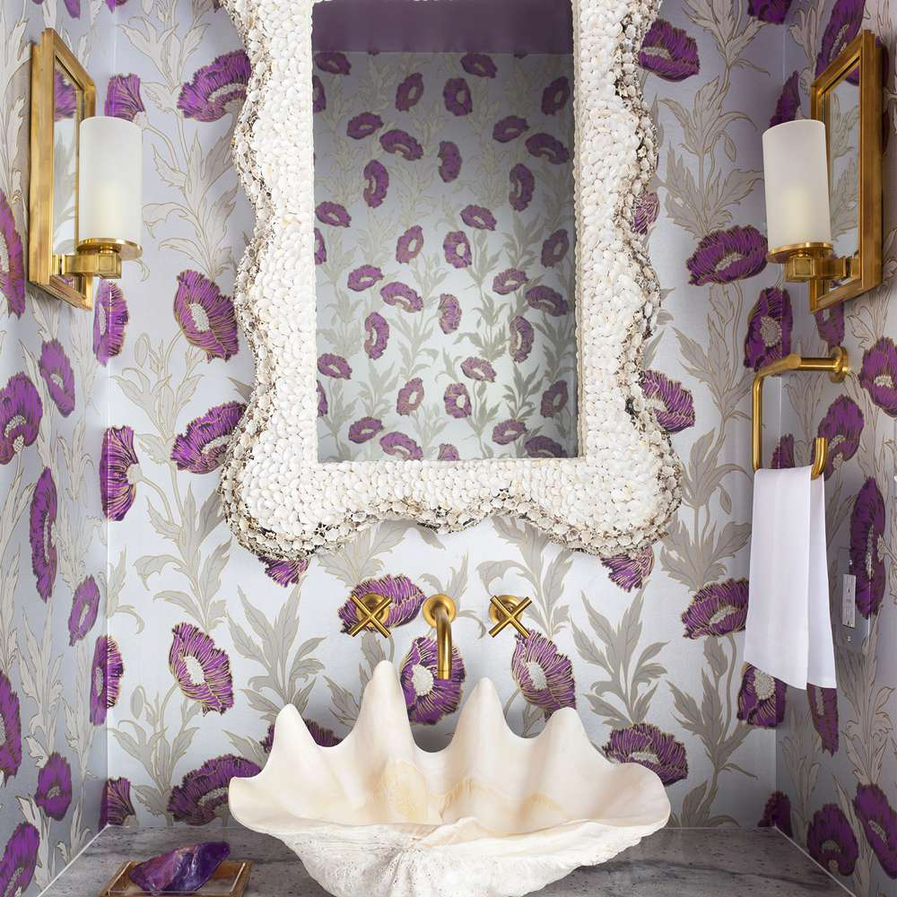 Powder room with large shell sink and purple flower wallpaper
