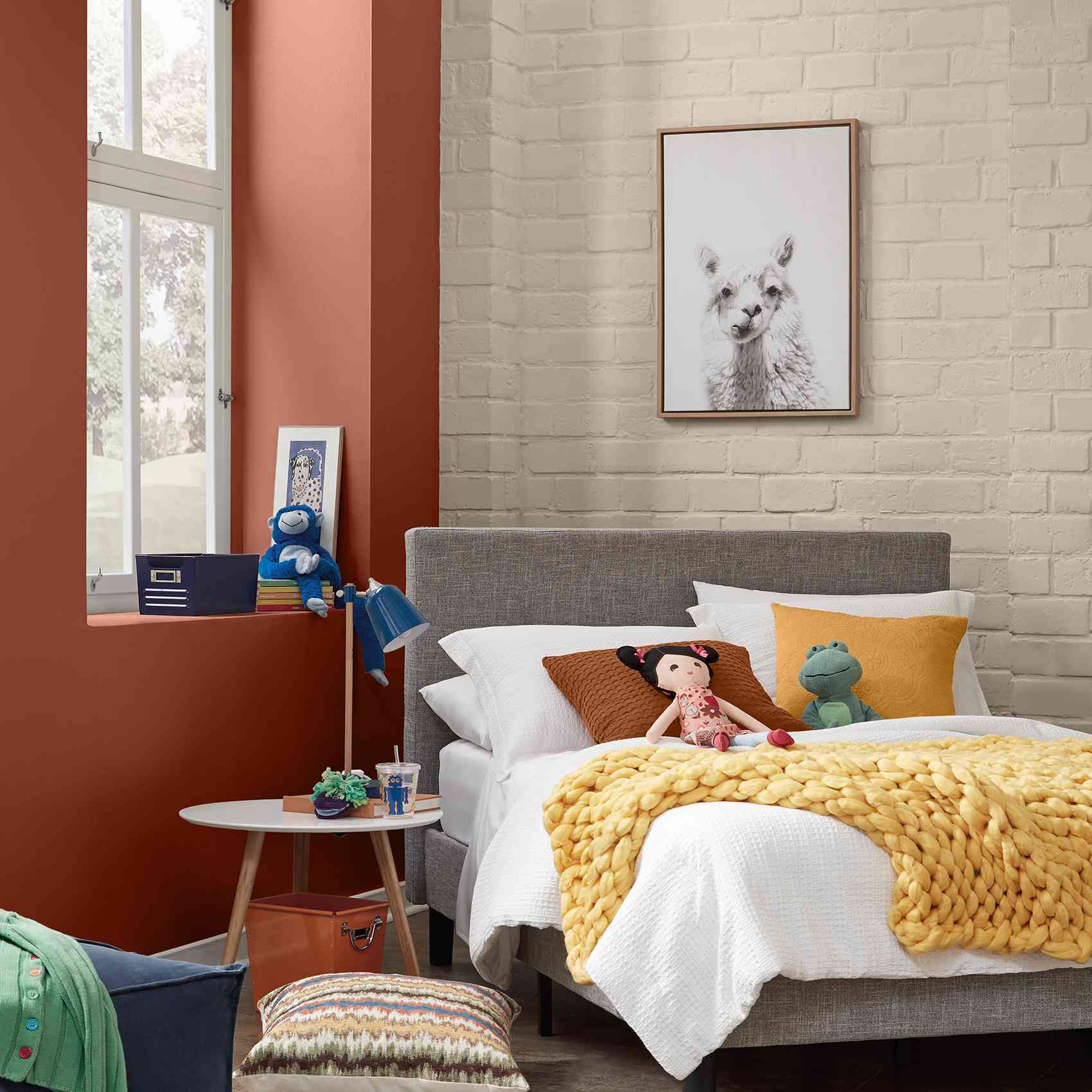 kids room with exposed brick and red wall