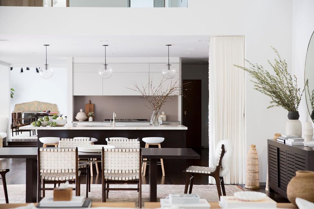 Open concept kitchen, dining room, and family room in neutral tones.