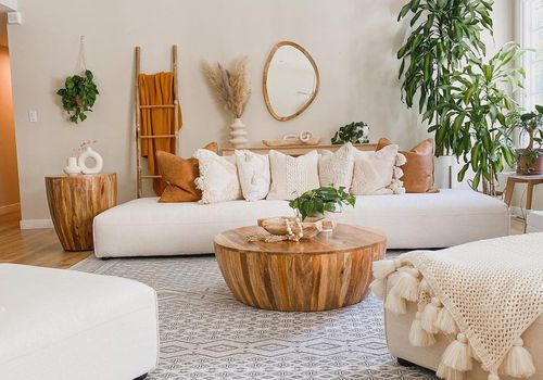 Boho living room filled with plants.