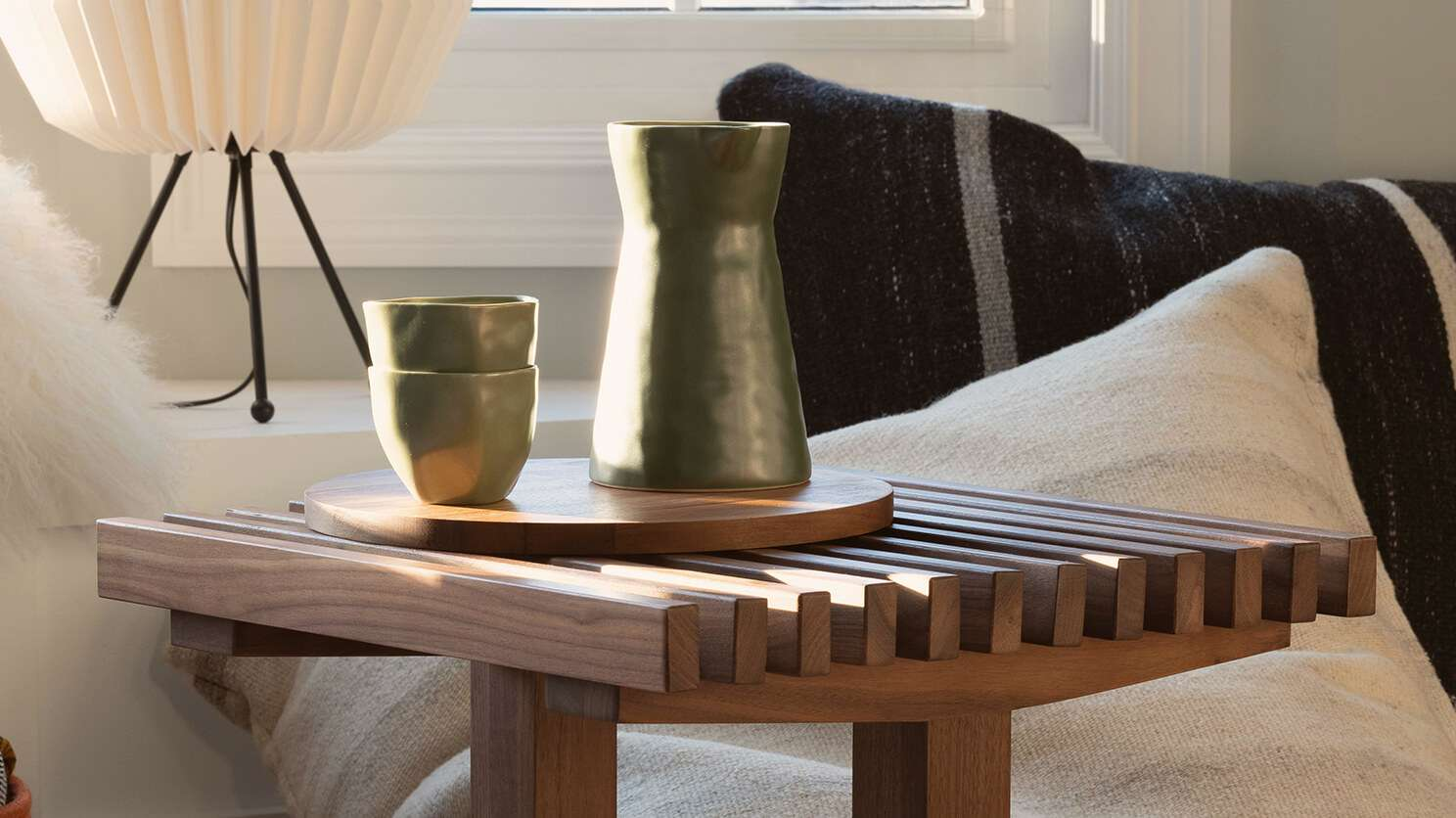 Wooden table with green vases.