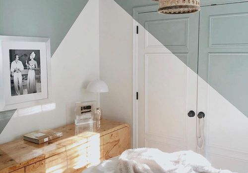 Guest bedroom with white and green closet.