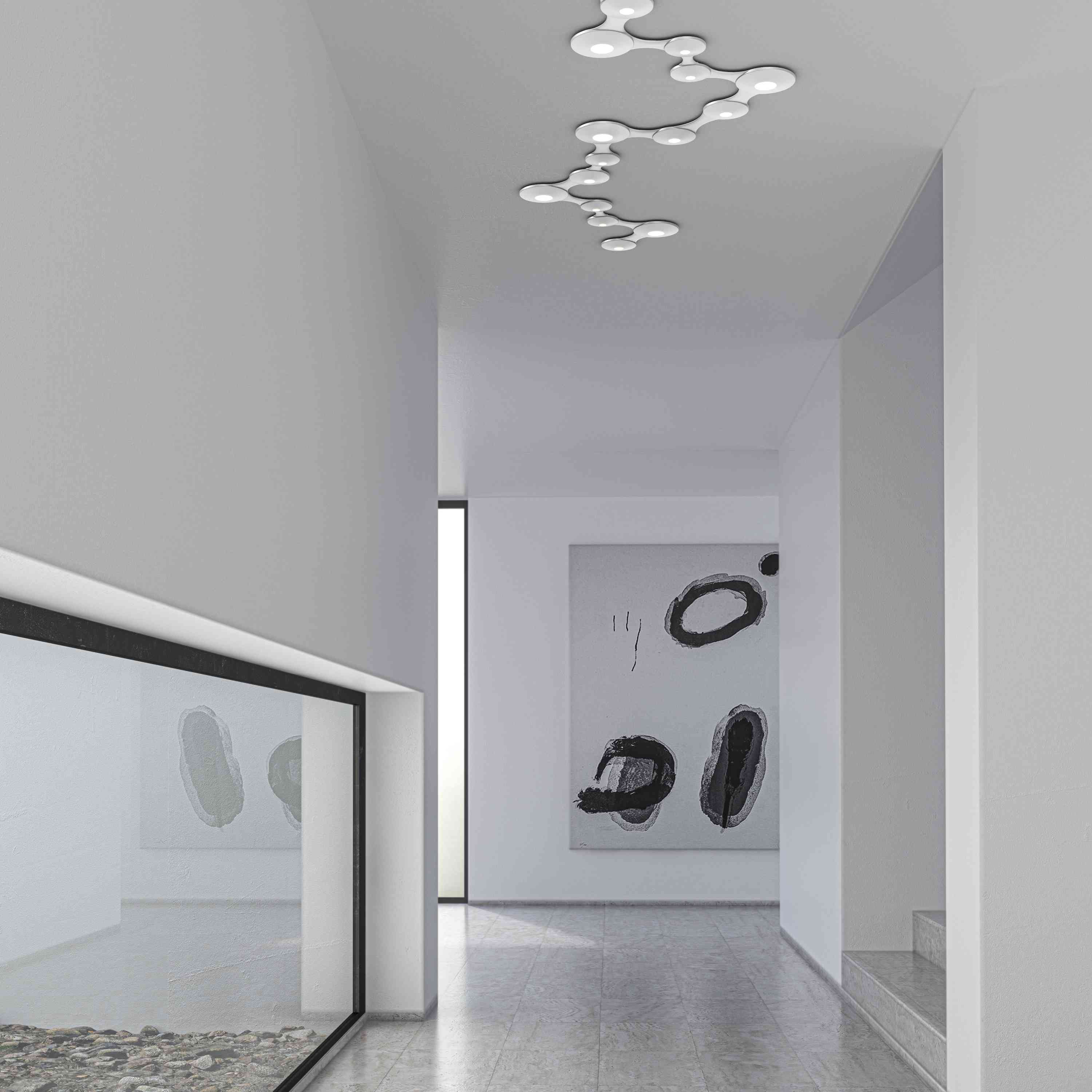 White room with intricate ceiling lighting.