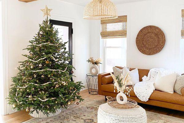 living room with leather sofa and christmas tree