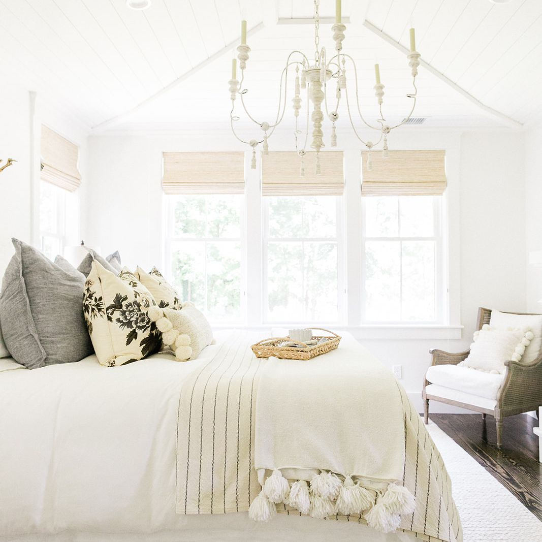 best bedroom ideas- farmhouse bedroom with layered white bedding