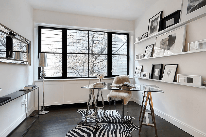 Black and white office with zebra rug.