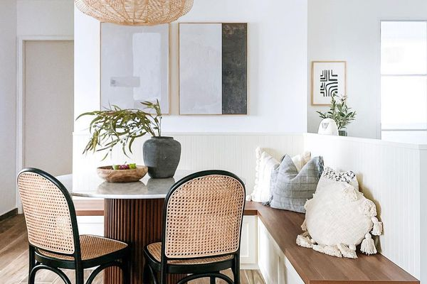 Dining nook with neutral artwork.