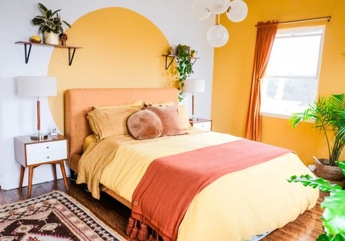 Bright yellow bedroom.