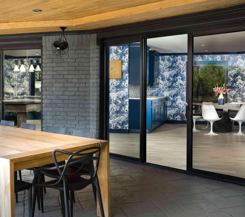 Outdoor area with sliding door to inside.