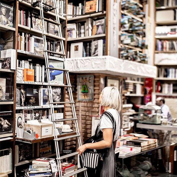 a woman in a bookstore