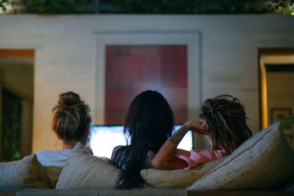 three friends watching tv