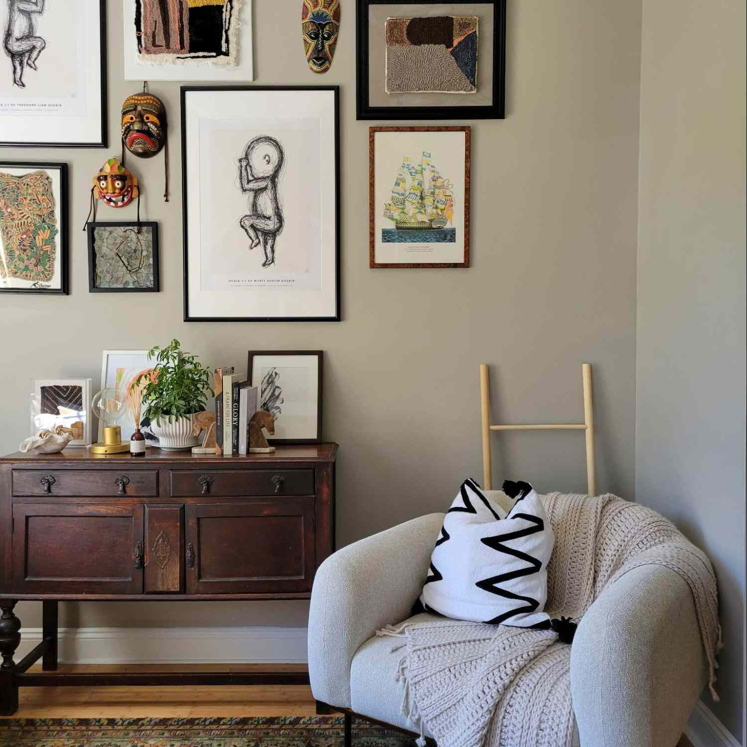Neutral sitting nook with gallery wall.