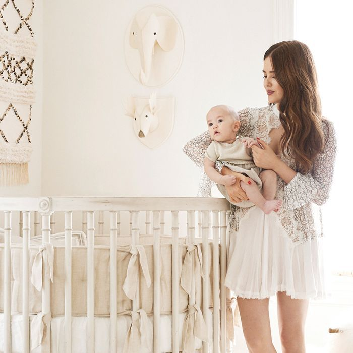 Lifestyle blogger Paola Alberdi with her baby in his nursery