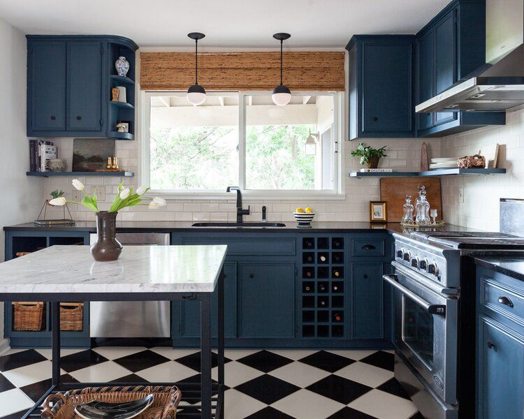 Blue cabinets and black and white tile