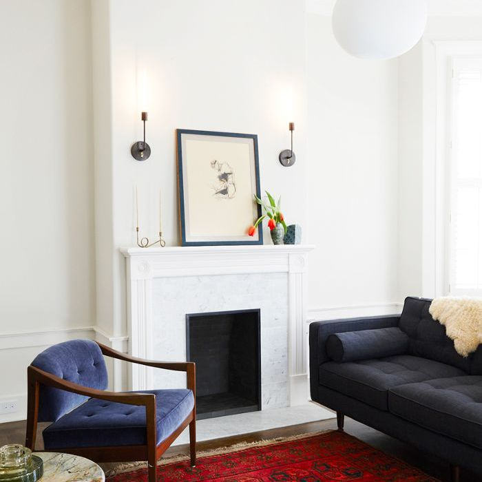 living room with a white mantle