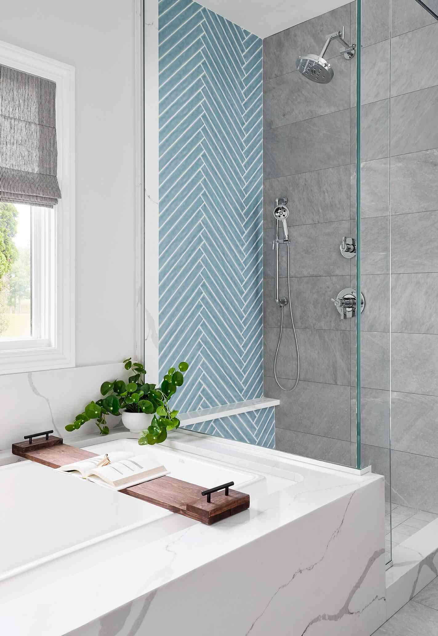 A small primary bathroom with a shower lined with two glass walls