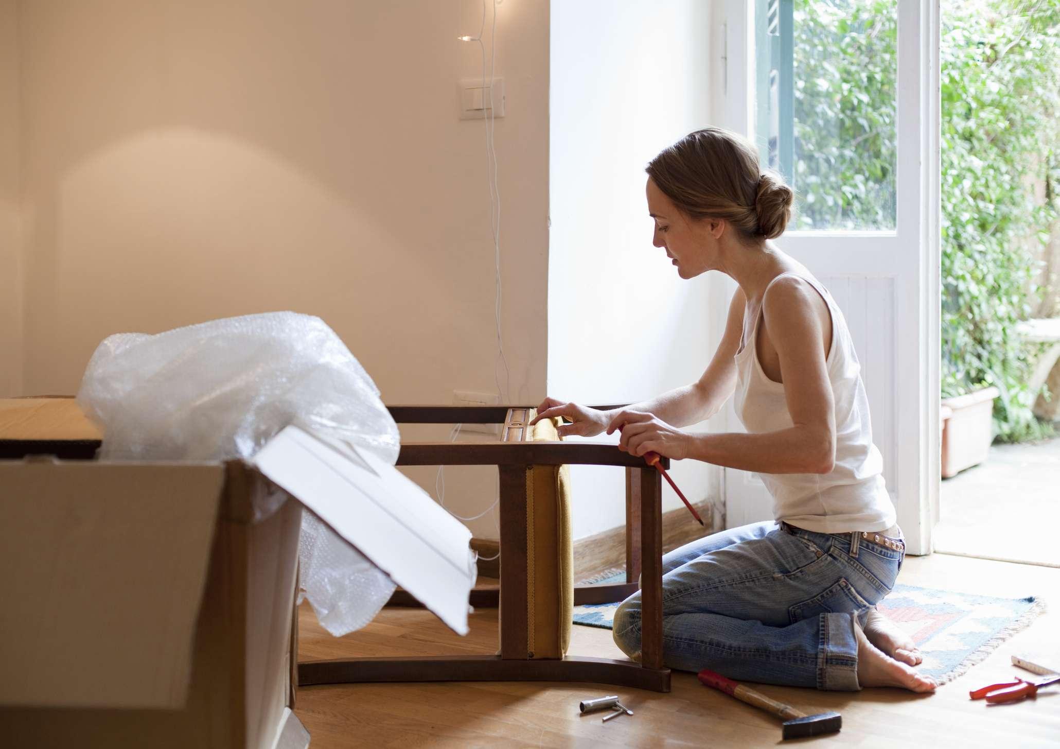 woman moving furniture