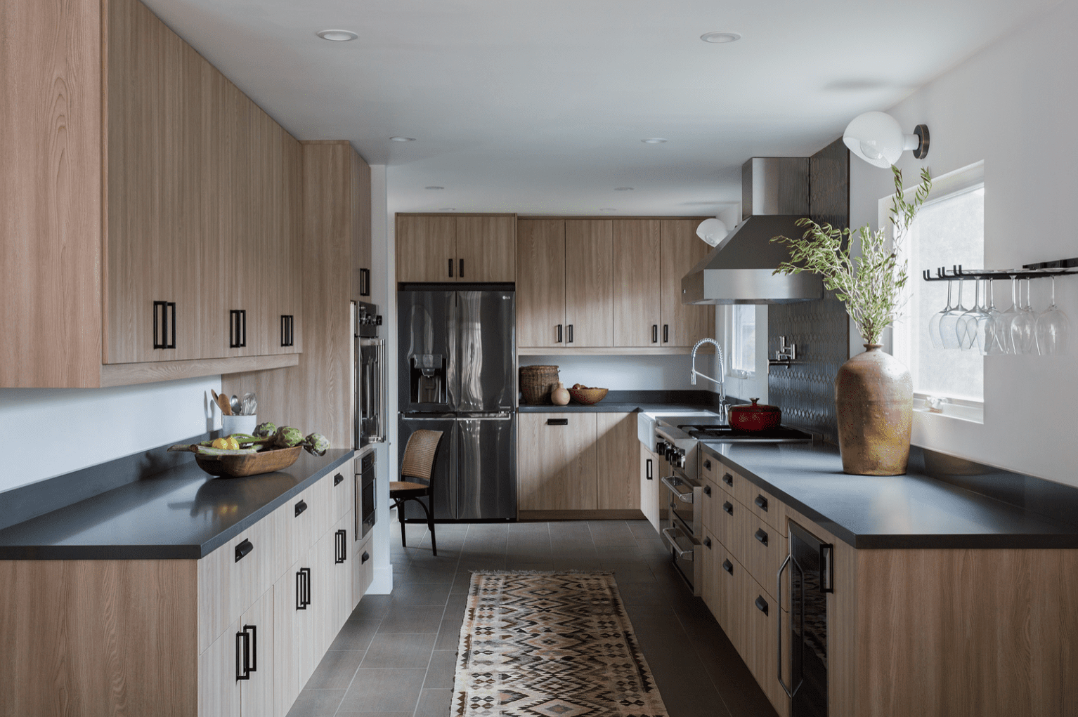 A large kitchen lined with wood cabinets