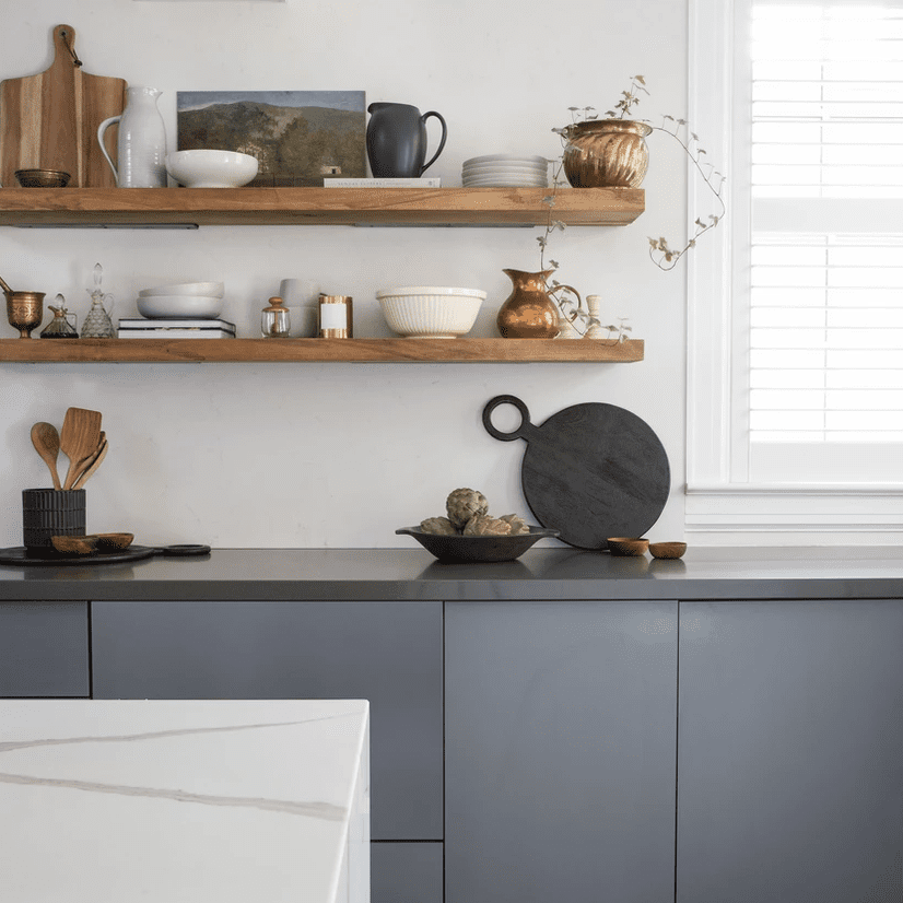 A sleek kitchen with blue-gray cabinets
