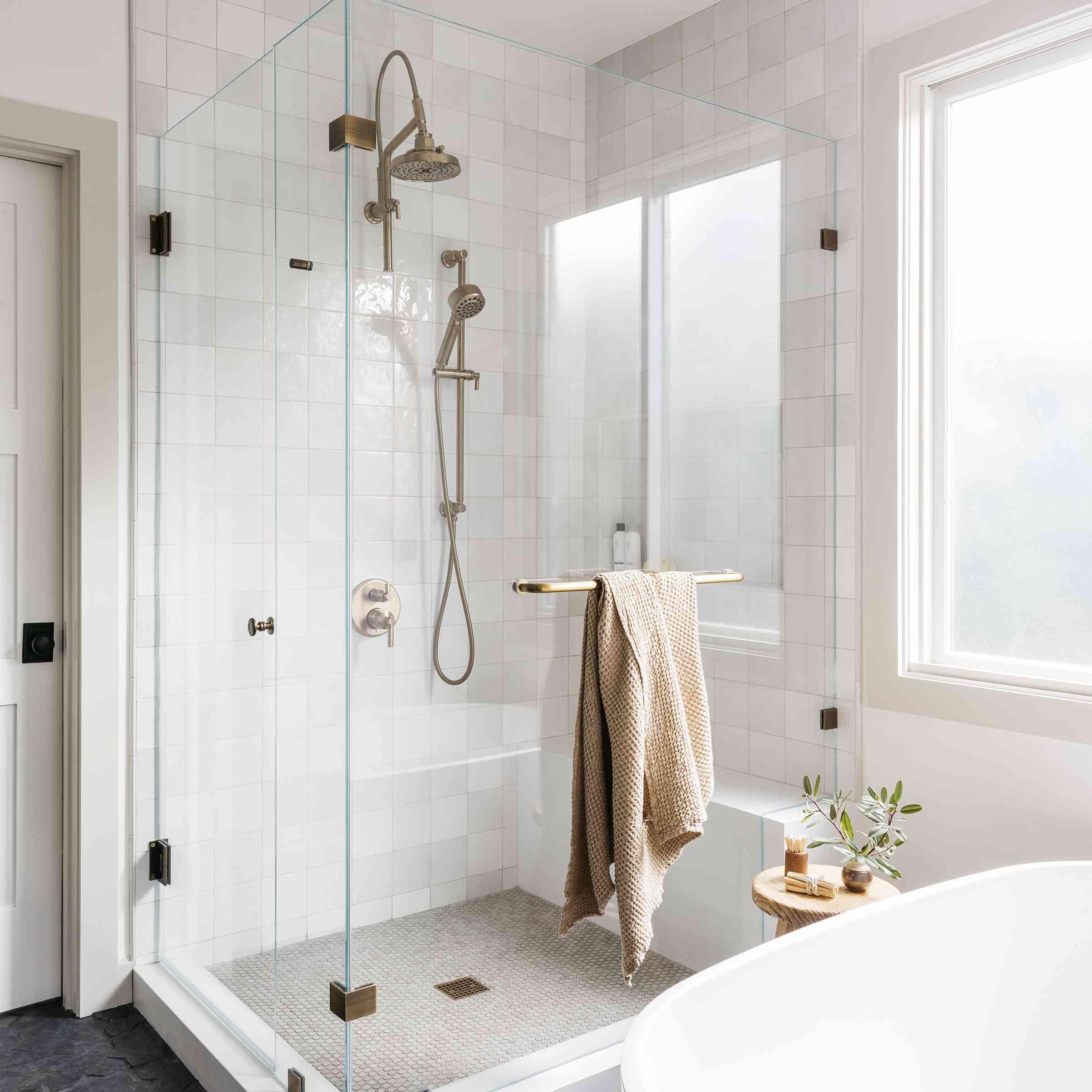 Brett Foken home tour - charcoal tile bathroom with light tiled shower