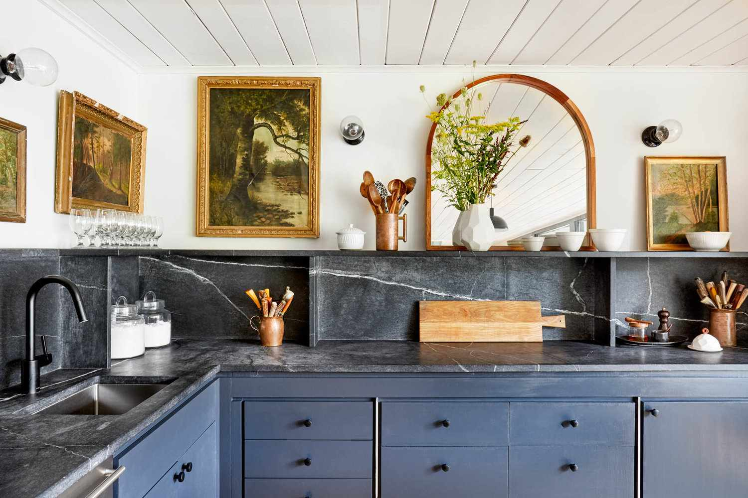 best kitchen ideas - blue and gray kitchen with antique paintings