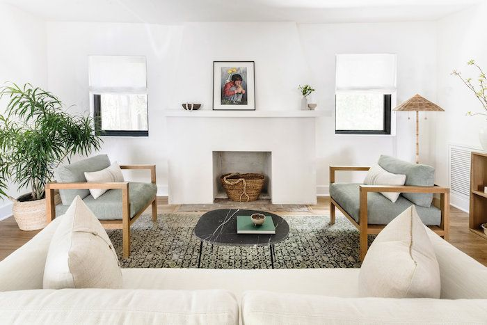 neutral sage green, white and brown living room. white fireplace