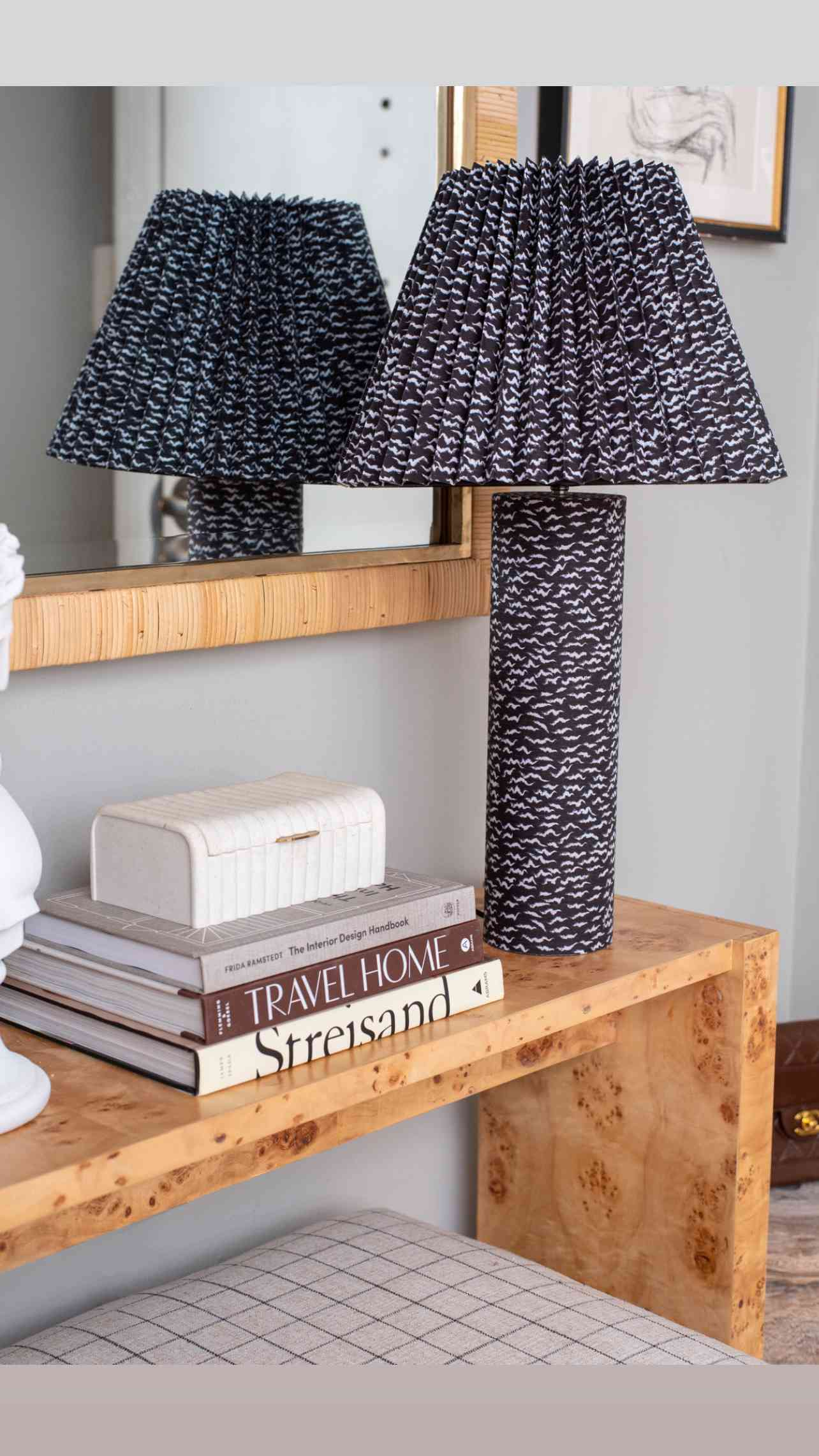 Accent lamp on burl wood side table.