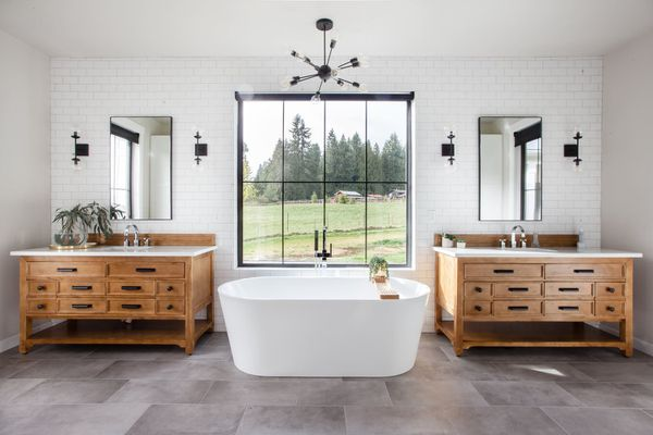 freestanding tub with double vanities and large window