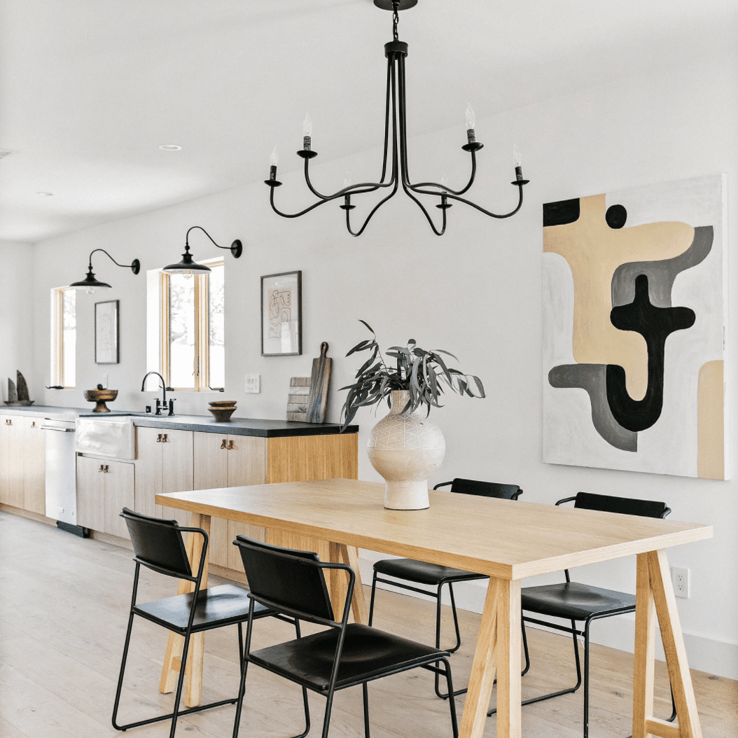 An open-concept kitchen with similar black lighting fixtures