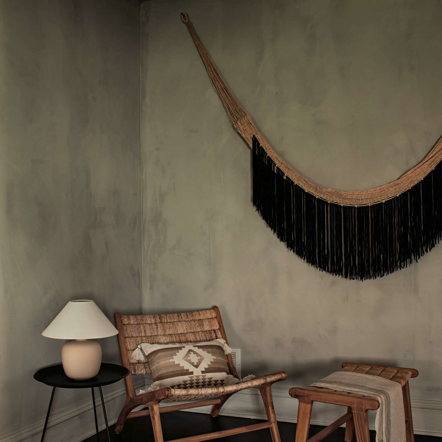 Moody boho chic corner reading nook with woven elements