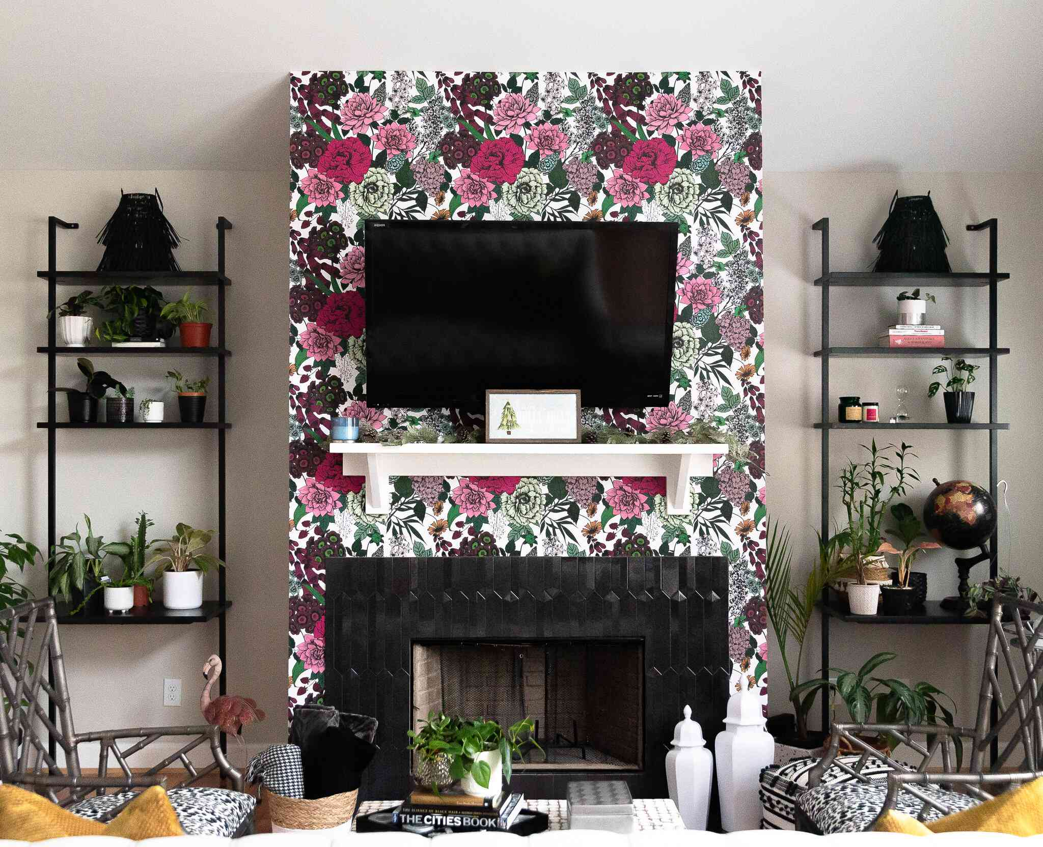 Living room with graphic floral wallpaper and plant shelves