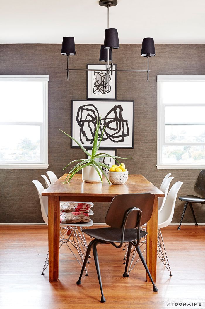 Grass cloth dining room with mixed chairs
