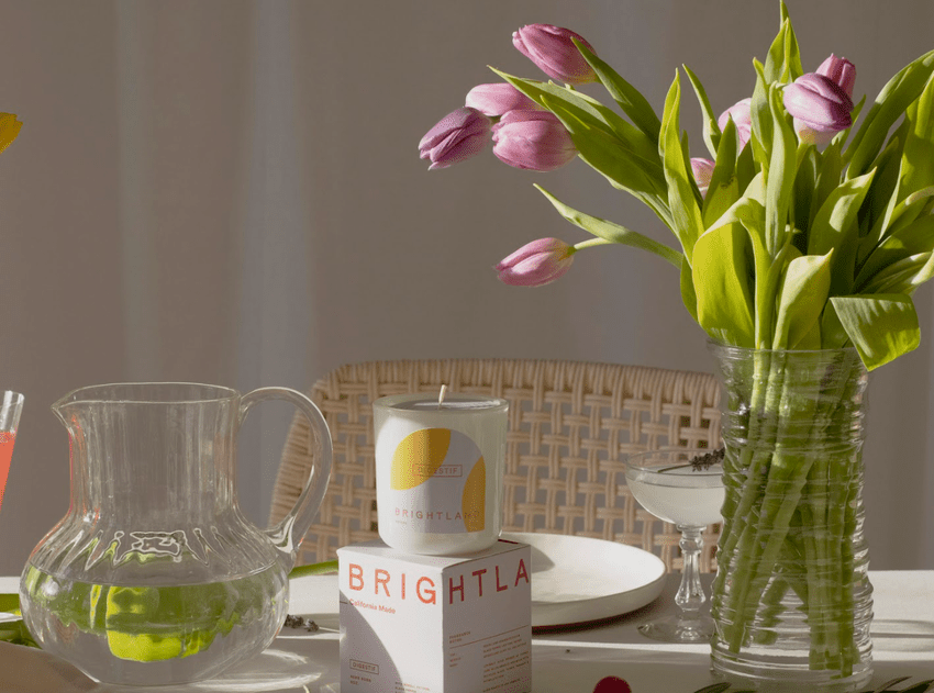 Brightland Candle, digestif with tulips on a table
