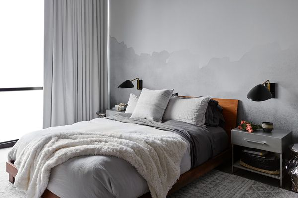 Fresh, gray bedroom with watercolor-effect mural wall