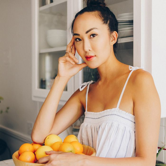 Chriselle Lim with a bowl of oranges