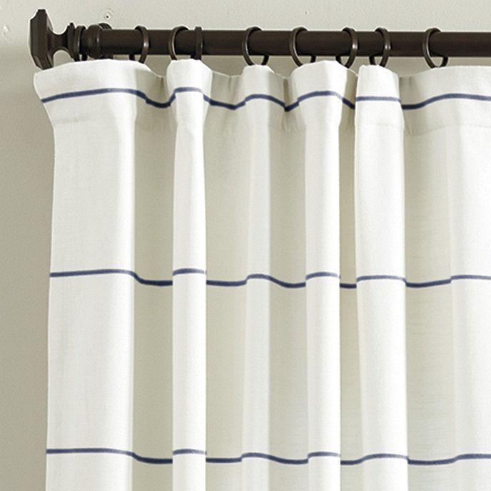 White curtains lined with thin blue stripes
