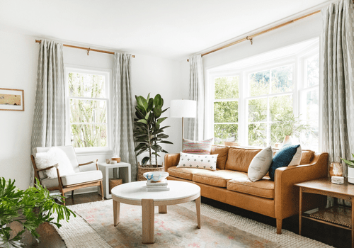 A living room with printed curtains