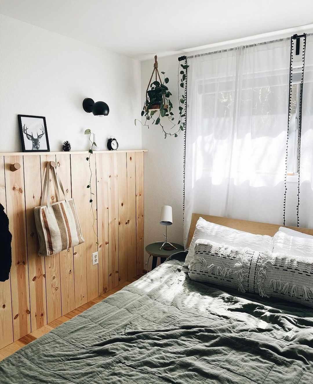 Cozy bedroom with sage green quilt.