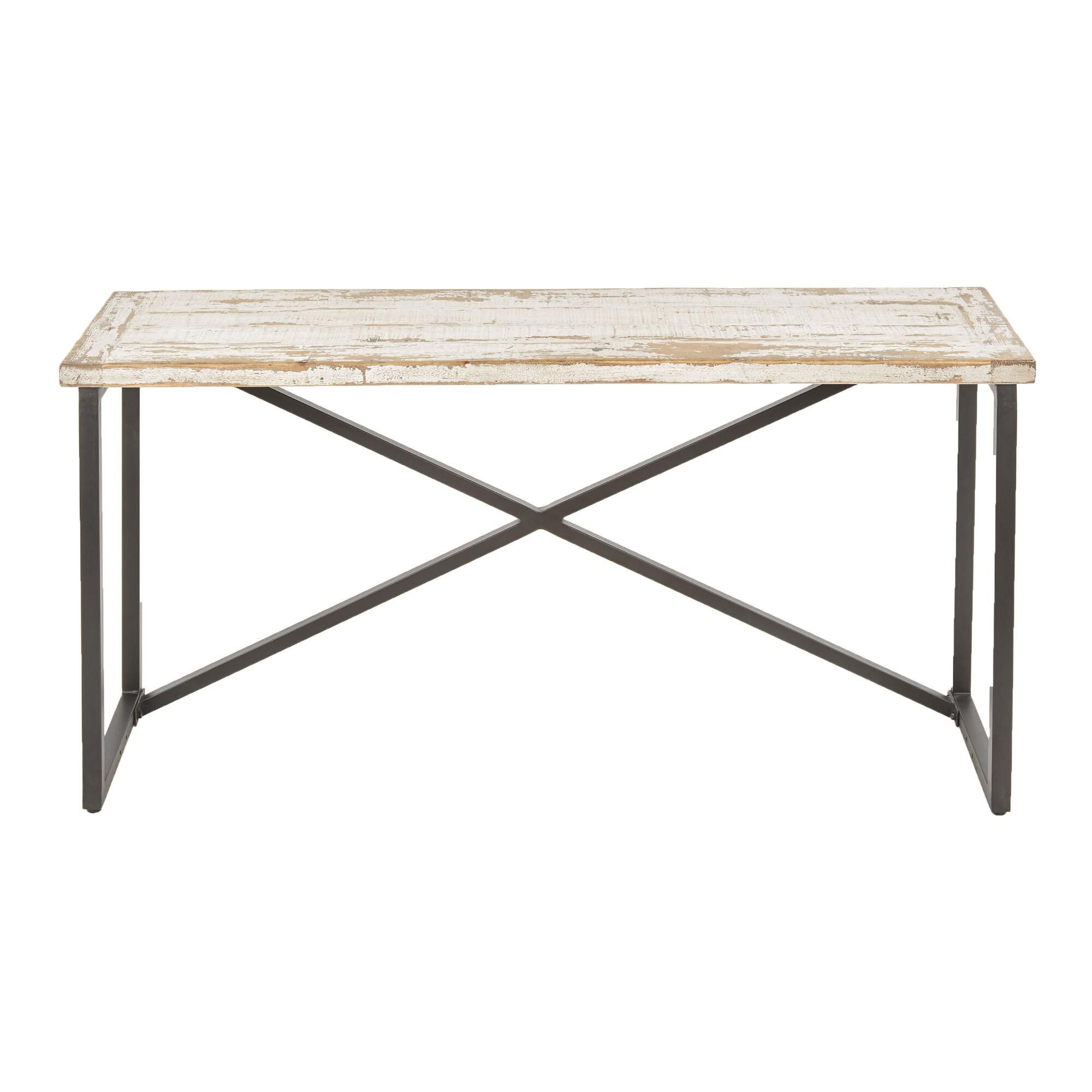 A whitewashed pine console table with a black metal base.