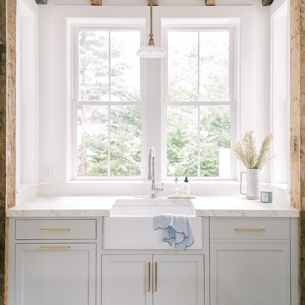 Nook of kitchen with white sink.