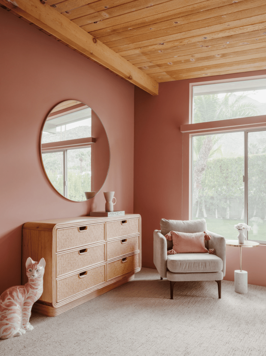 A blush pink bedroom with lavender accent furniture