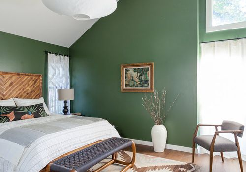 Green angular bedroom space.