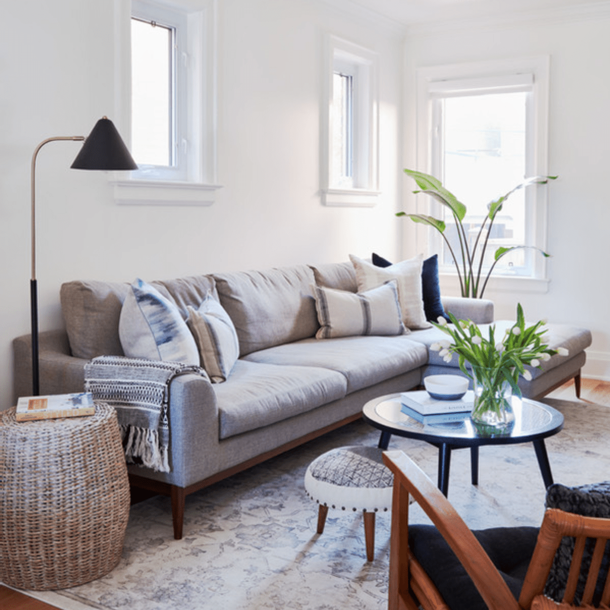White living room with gray couch