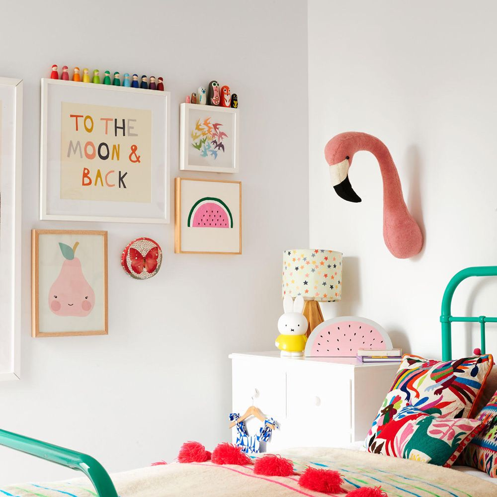 Pink and teal girl's bedroom with stuffed flamingo head wall decor