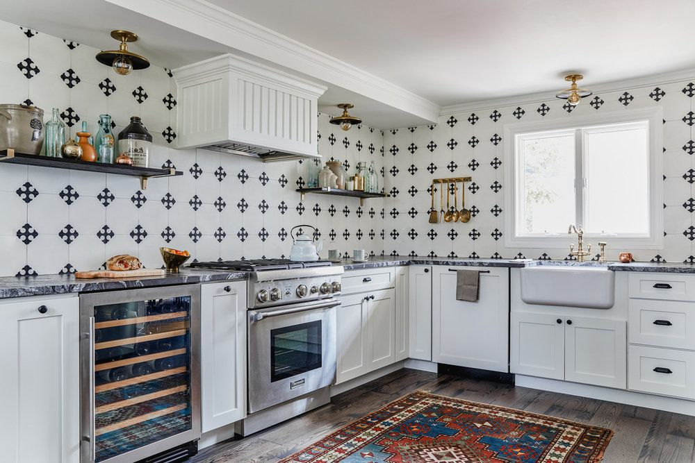Country kitchen with extended black and white tile backsplash