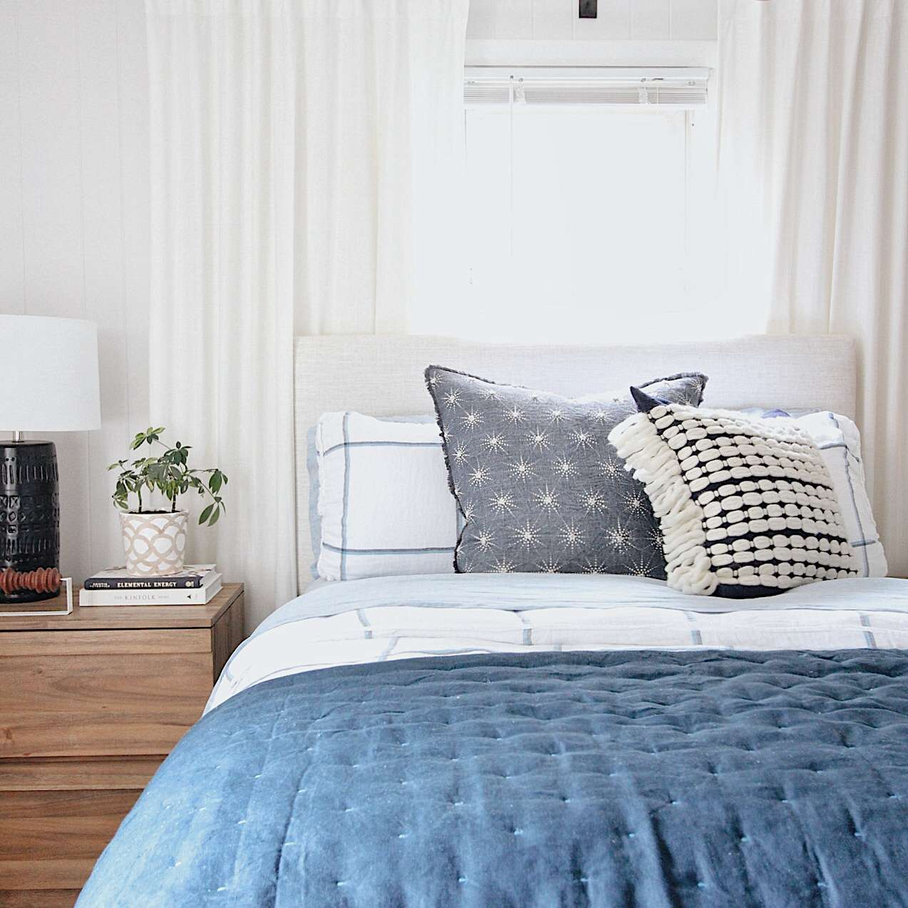 Bedroom with blue bedding