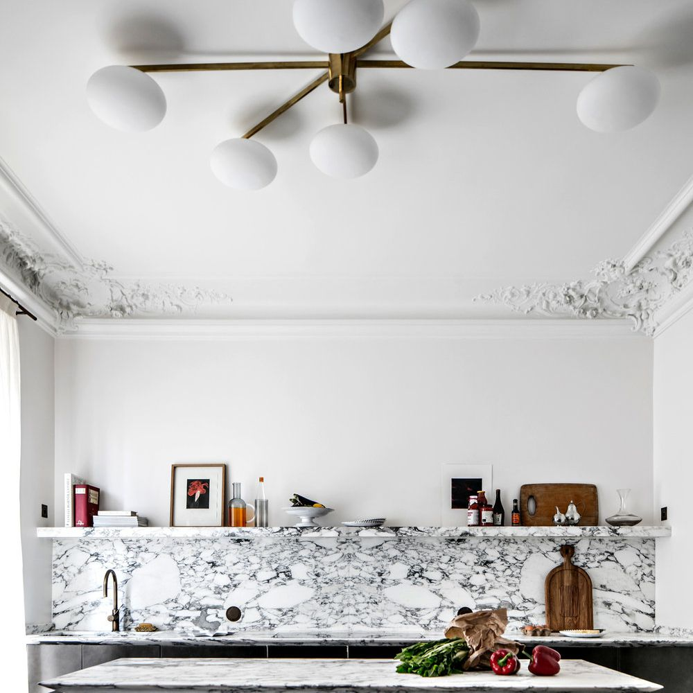 Minimalist kitchen with molded ceiling, marble countertops