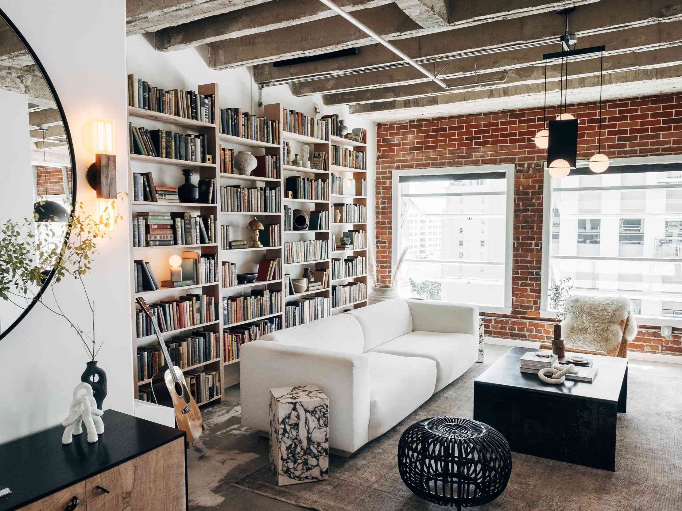 White, cement, and brick living room