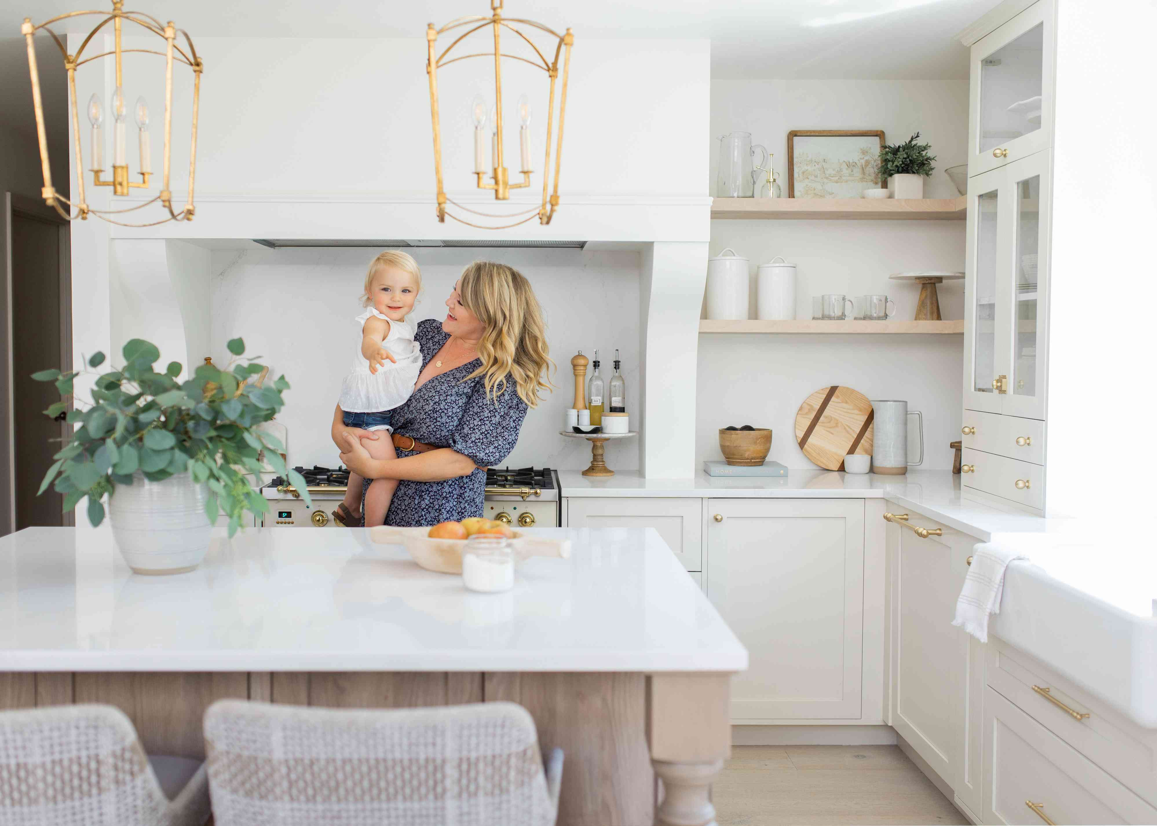 Jones and her baby in the kitchen.