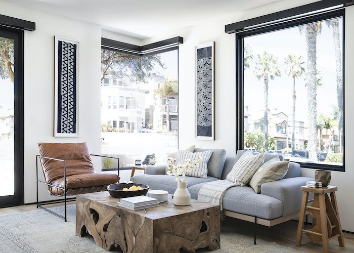 beachy modern living room with brown and light blue color palette, leather accent chair